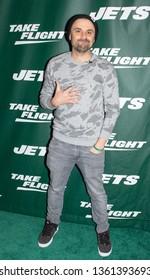 NEW YORK, NEW YORK - APRIL 4, 2019: Gary V. walk the New York Jets Uniform Reveal Green Carpet at Gotham Hall in Manhattan, New York on April 4, 2019.