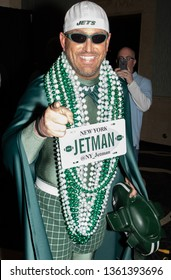 NEW YORK, NEW YORK - APRIL 4, 2019: Jet Man walk the New York Jets Uniform Reveal Green Carpet at Gotham Hall in Manhattan, New York on April 4, 2019.