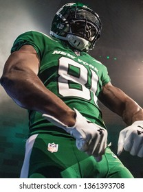 NEW YORK, NEW YORK - APRIL 4, 2019: Quincy Enunwa walk the New York Jets Uniform Reveal Green Carpet at Gotham Hall in Manhattan, New York on April 4, 2019.