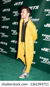 NEW YORK, NEW YORK - APRIL 4, 2019: MAX walk the New York Jets Uniform Reveal Green Carpet at Gotham Hall in Manhattan, New York on April 4, 2019.