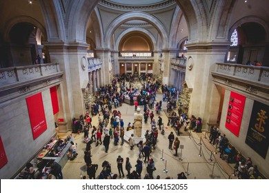 NEW YORK, NEW YORK - APRIL 5, 2018: People crowd the entry foyer at the Metropolitan Museum of Art in New York City