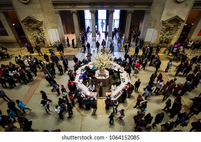 NEW YORK, NEW YORK - APRIL 5, 2018: Looking down at the crowd at the Met in New York City