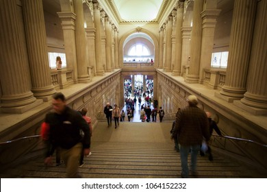 NEW YORK, NEW YORK - APRIL 5, 2018: People climb up and down the stairs of the Metropolitan Museum of Art in New York City