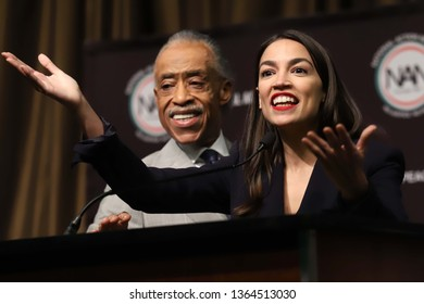 NEW YORK - APRIL 5, 2019: Al Sharpton and Alexandria Ocasio-Cortez speak during the National Action Network Convention on April 5, 2019, in New York.