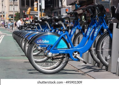 New York - Aug 20: several bicycles from city bike parked in a row waiting to be hired  in downtown New York on August 20, 2014 in New York, USA