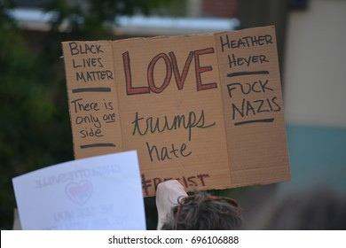New York, New York - August 13, 2017: Protesters in Union Square carrying signs denouncing neo-nazi violence in Charlottesville, Virginia, and President Trump in New York City in 2017.