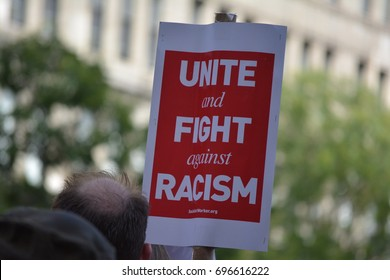 New York, New York. - August 13, 2017: People carrying signs at a rally in Union Square denouncing neo-nazi violence in Charlottesville, Virginia and President Trump in 2017 in New York City.