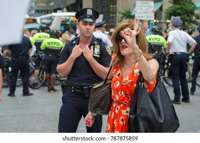 "NEW YORK - August 13, 2017: A counter protester attempts to troll anti-Trump protesters with a 4chan-derived ""white power"" hand gesture."