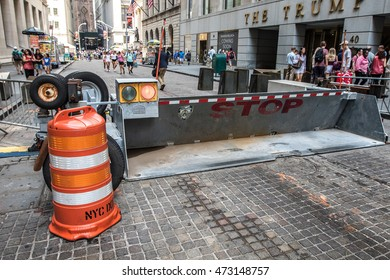 New York, August 17, 2016: A police barricade prevents automotive access on Wall street.