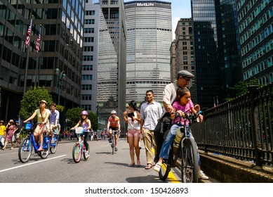 NEW YORK - AUGUST 17:  Bicyclist, joggers and walkers enjoy Car Free Streets on Park Ave as part of New York City's Summer Streets August 17, 2013 in New York City.