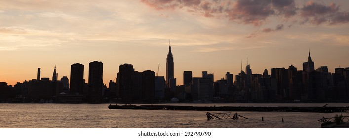 NEW YORK - AUGUST 17: Manhattan Skyline at sunset on August 17, 2013 in New York. Manhattan is the smallest yet most densely populated of NYC's five boroughs.