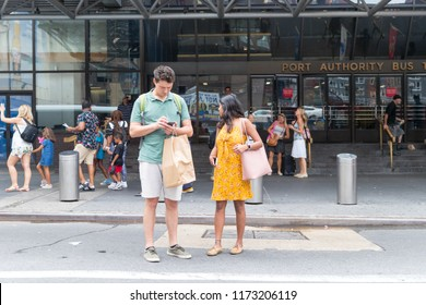 New York, August 18, 2018:a couple crossing New York city street.