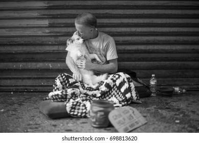 NEW YORK - AUGUST 19, 2015: Homeless man in Manhatten and his trusted Dog. New York City. August 19, 2015 in New York.