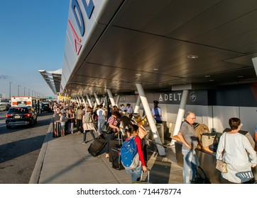 New York, August 19, 2017: People are going curbside check-in for Delta Airline flights at JFK airport.