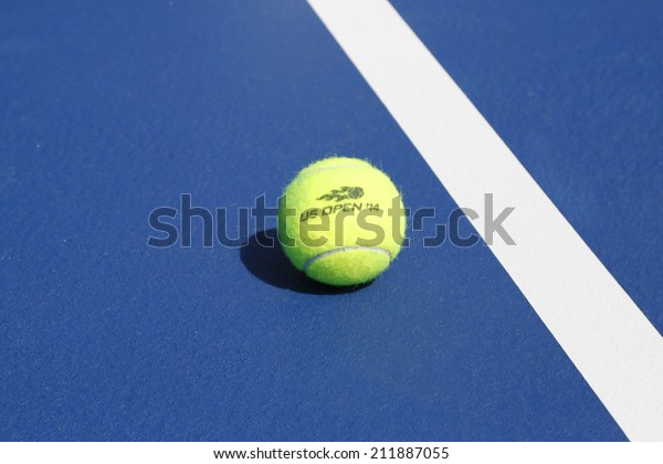 NEW YORK - AUGUST 19: Wilson tennis ball on tennis court at Arthur Ashe Stadium on August 19, 2014 in New York. Wilson is the Official Ball of the US Open since 1979