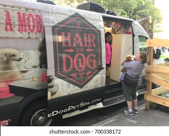 NEW YORK- AUGUST 2017: A mobile salon for dogs. The 2016 U.S. market size for pet industry was 66 billion dollars.  Pet Services grooming & boarding was 6 billion dollars.