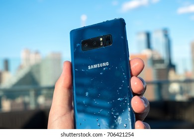 NEW YORK, AUGUST 2017 - Samsung Galaxy Note 8 smartphone is displayed with visible water droplets after waterproof test.