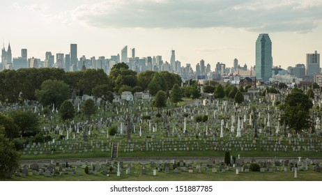 NEW YORK - AUGUST 21: Calvary Cemetery with Manhattan skyline on August 21, 2013 in New York. Calvary Cemetery is a cemetery in Queens, containing more than 3 million burials.