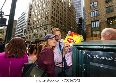 NEW YORK - AUGUST 21:  People Look Through Home Made Eclipse Viewers Made Out of Cereal Boxes As They Try and View Eclipse On And Near 42nd Street By Grand Central August 21, 2017 in New York City.