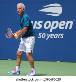 NEW YORK - AUGUST 22, 2018: Seven times Grand Slam Champion John McEnroe in action during 2018 US Open exhibition match at newly open Louis Armstrong Stadium at Billie Jean King National Tennis Center