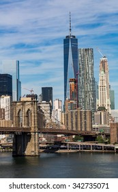 NEW YORK - AUGUST 22: Views of the Brooklyn Bridge on a summer day on August 22, 2015. Its a famous and iconic bridge in New York, which passes the east river.