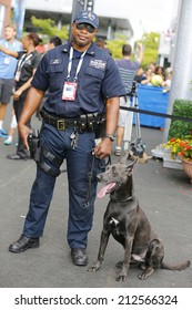 NEW YORK - AUGUST 23: NYPD transit bureau K-9 police officer and Belgian Shepherd K-9 Sam  providing security at National Tennis Center during US Open 2014 on August 23, 2014 in New York