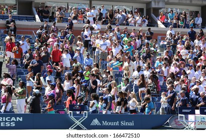 NEW YORK -AUGUST 24 Spectators standing at Arthur Ashe Stadium for American anthem performance during opening ceremony for Arthur Ashe Kids Day 2013 at  National Tennis Center on August 24, 2013 in NY