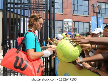 NEW YORK - AUGUST 26, 2018: Professional tennis player Stefanos Tsitsipas of Greece signs autographs after practice for 2018 US Open at Billie Jean King National Tennis Center