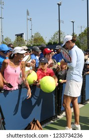 NEW YORK - AUGUST 26, 2018: Grand Slam champion Lindsay Davenport sighs autographs after Women's Champions Doubles match at 2018 US Open at National Tennis Center in New York