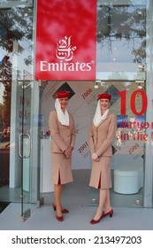 NEW YORK - AUGUST 26: Emirates Airlines flight attendants at the Emirates Airlines booth at the Billie Jean King National Tennis Center during US Open 2014 on August 26, 2014 in New York