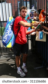 NEW YORK - AUGUST 27, 2015: Two times Grand Slam champion Stanislas Wawrinka of Switzerland signing autographs after practice for US Open 2015 at Billie Jean King National Tennis Center in New York