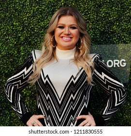 NEW YORK - AUGUST 27, 2018: Grammy Award Winning Superstar Kelly Clarkson on the blue carpet before 2018 US Open opening night ceremony at Tennis Center in New York