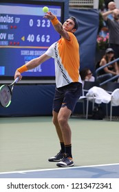NEW YORK - AUGUST 27, 2018: Professional tennis player Karen Khachanov of Russia in action during first round match at the 2018 US Open at Billie Jean King National Tennis Center