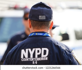 NEW YORK - AUGUST 27, 2018: NYPD counter terrorism  K-9 police officer provides security at National Tennis Center during 201U8 S Open in New York