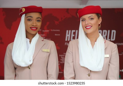 NEW YORK - AUGUST 27, 2019: Emirates Airlines flight attendants at the Emirates Airlines booth during 2019 US Open at the Billie Jean King National Tennis Center in New York