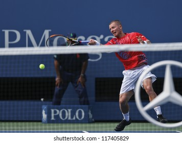 NEW YORK - AUGUST 27: Alex Bogomolov of Russia returns ball during 1st round match against Andy Murray of United Kingdom at US Open tennis tournament on August 27, 2012 in Flushing Meadows New York