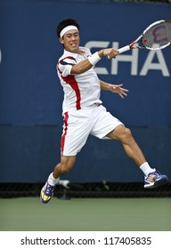 NEW YORK - AUGUST 27: Kei Nishikori of Japan returns ball during 1st round match against Guido Andreozzi of Argentina at US Open tennis tournament on August 27, 2012 in Flushing Meadows New York