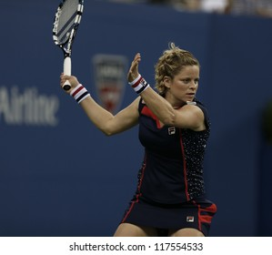 NEW YORK - AUGUST 27: Kim Clijsters of Belgium returns ball during 1st round match against Victoria Duval of USA at US Open tennis tournament on August 27, 2012 in Flushing Meadows New York