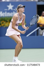NEW YORK - AUGUST 27: Maria Sharapova of Russia returns ball during 1st round match against Melinda Czink of Hungary at US Open tennis tournament on August 27, 2012 in Flushing Meadows New York