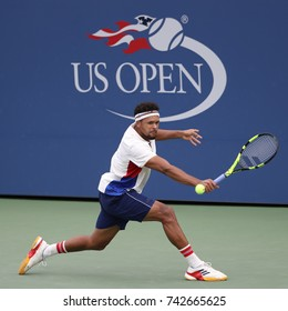 NEW YORK - AUGUST 28, 2017: Professional tennis player Jo-Wilfried Tsonga of France in action during his 2017 US Open first round match at Billie Jean King National Tennis Center