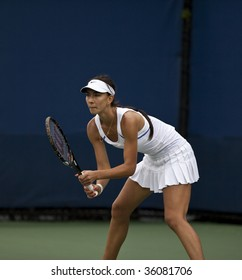 NEW YORK - AUGUST 28: Anastasia Pivovarova of Russia returns a shot to Marta Domachowska of Poland during the US Open qualifying match on August 28 2009 in New York