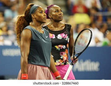 NEW YORK - AUGUST 29, 2013: Grand Slam champions Serena Williams and Venus Williams during their first round doubles match at US Open 2013 at Billie Jean King National Tennis Center in New York