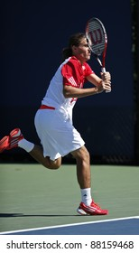 NEW YORK - AUGUST 29: Alexandr Dolgopolov of Ukraine returns ball during 1st round match against Frederico Gil of Portugal at USTA Billie Jean King National Tennis Center on August 29, 2011 in NYC