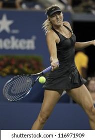 NEW YORK - AUGUST 29: Maria Sharapova of Russia returns ball during 2nd round match against Lourdes Dominguez Lino of Spain at US Open tennis tournament on August 29, 2012 in Flushing Meadows New York