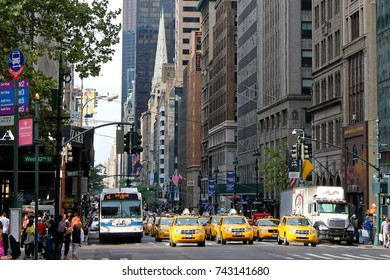 New York - August 3, 2017, Yellow taxi cabs ride on 5th Avenue in New York City, USA