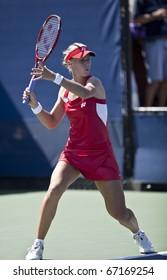 NEW YORK - AUGUST 30: Elena Dementieva returns ball during match against Olga Govortseva of Belarus at US Open tennis tournament on August 30, 2010, New York.