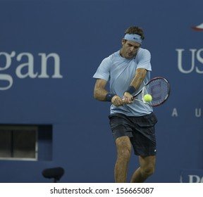 NEW YORK - AUGUST 30: Juan Martin Del Potro of Argentina returns ball during 2nd round match against Lleyton Hewitt of Australia at 2013 US Open at USTA Center on August 30, 2013 in New York