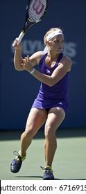 NEW YORK - AUGUST 30: Melanie Oudin of USA returns ball during match against Olga Savchuk of Ukraine at US Open tennis tournament on August 30, 2010, New York.