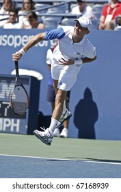 NEW YORK - AUGUST 30: Nikolay Davidenko of Russia returns ball during match against Michael Russell of USA at US Open tennis tournament on August 30, 2010, New York.