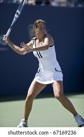 NEW YORK - AUGUST 30: Olga Savchuk of Ukraine returns ball during match against Melanie Oudin of USA at US Open tennis tournament on August 30, 2010, New York.
